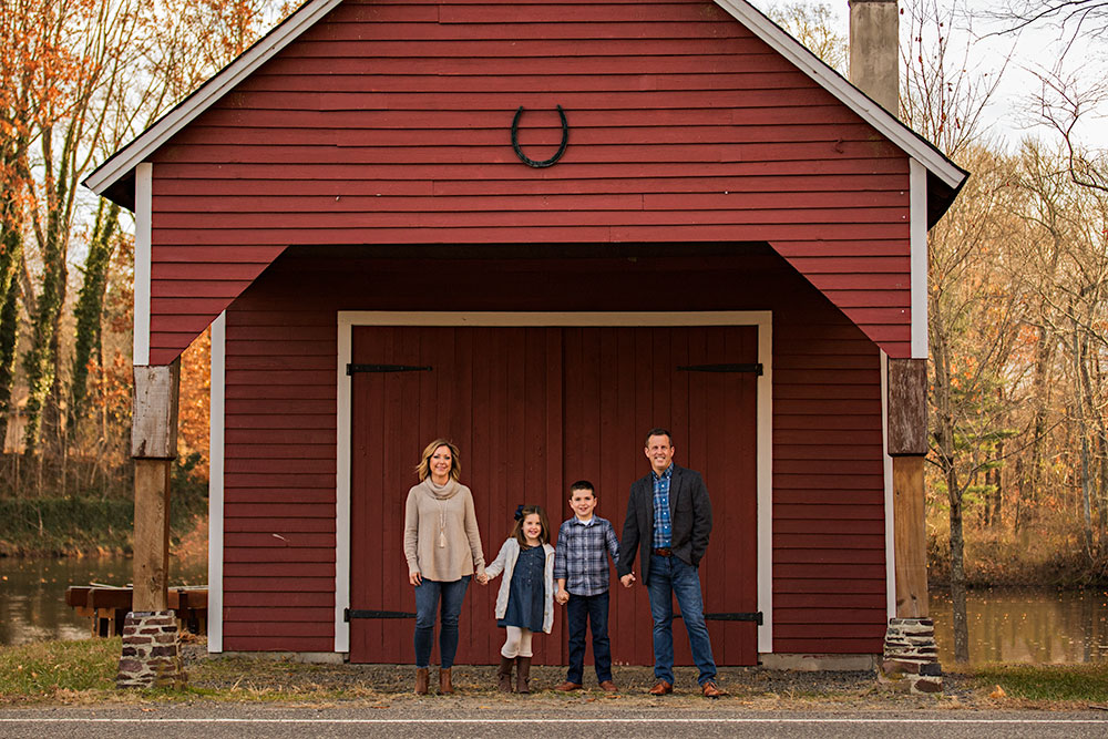 NancyElizabeth Photography | New Jersey Family Photographer | Family Holding Hands infront of Red Barn