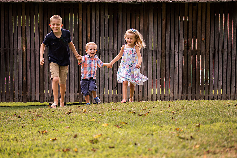 NancyElizabeth Photography | New Jersey Child Photographer | 3 Siblings Holding Hands Running