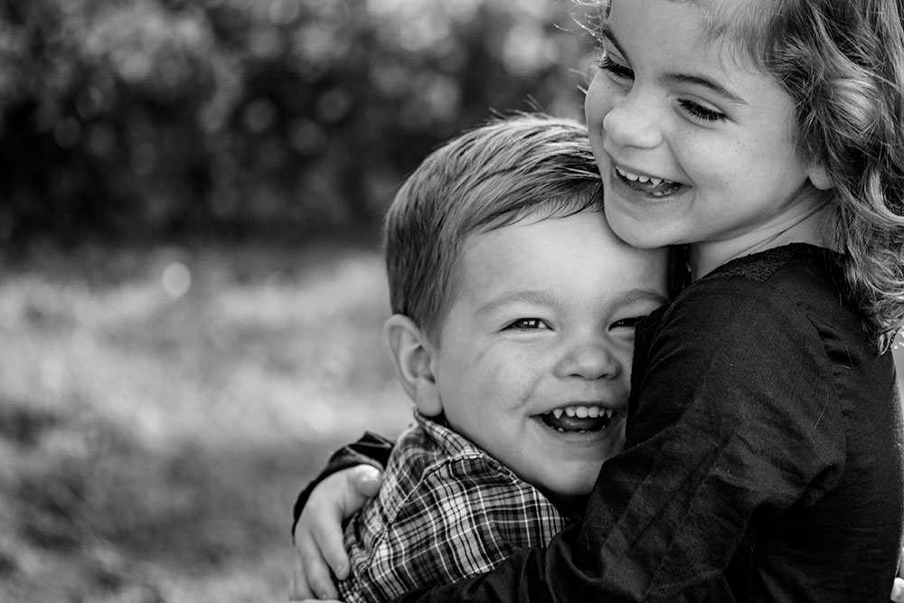 New Jersey Family Photographer, Brother Sister Hugging and Smiling