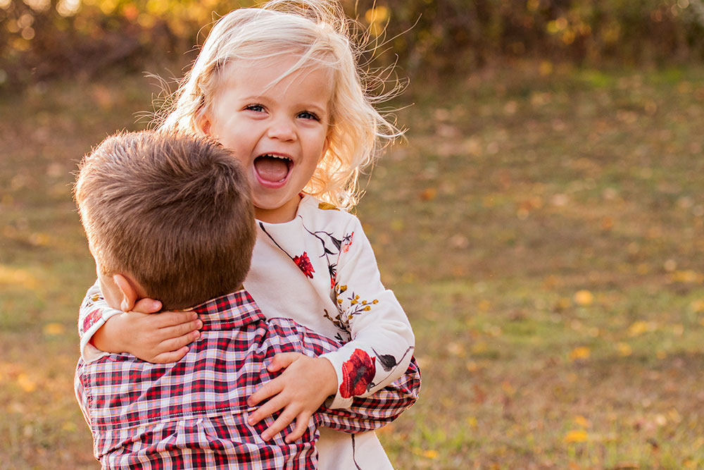 New Jersey Family Photographer, Brother Sister Hugging and Laughing