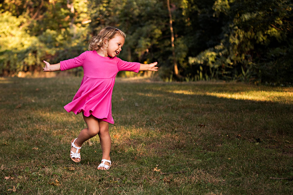NancyElizabeth Photography | New Jersey Child Photographer | Girl in Pink Dress Twirling