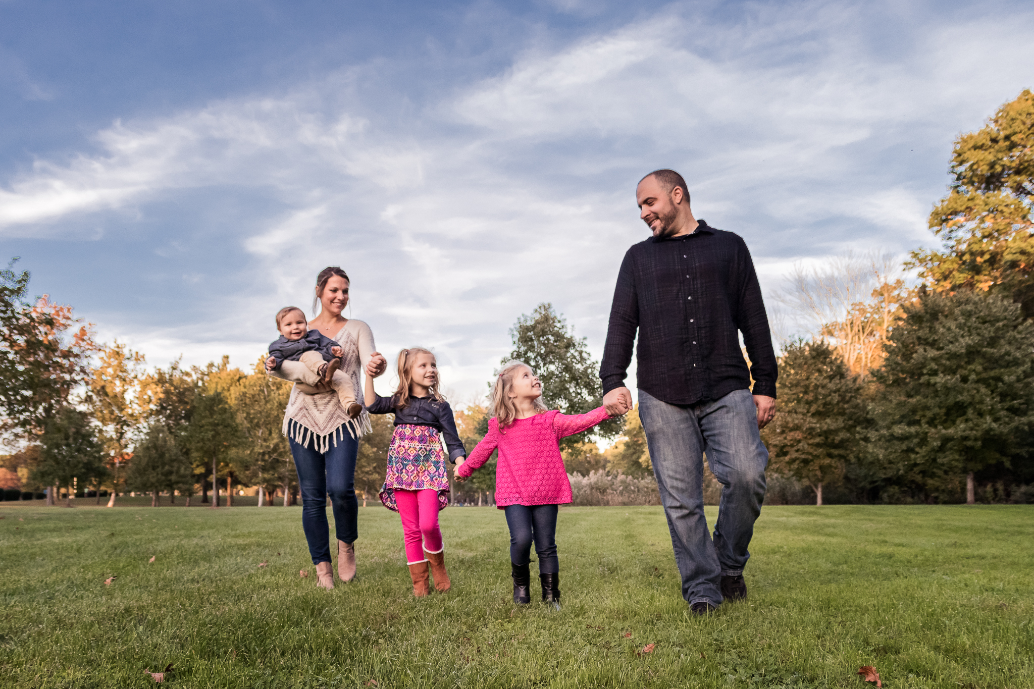 New Jersey Family Photographer, Nancy Elizabeth Photography, Family Walking with Blue Sky