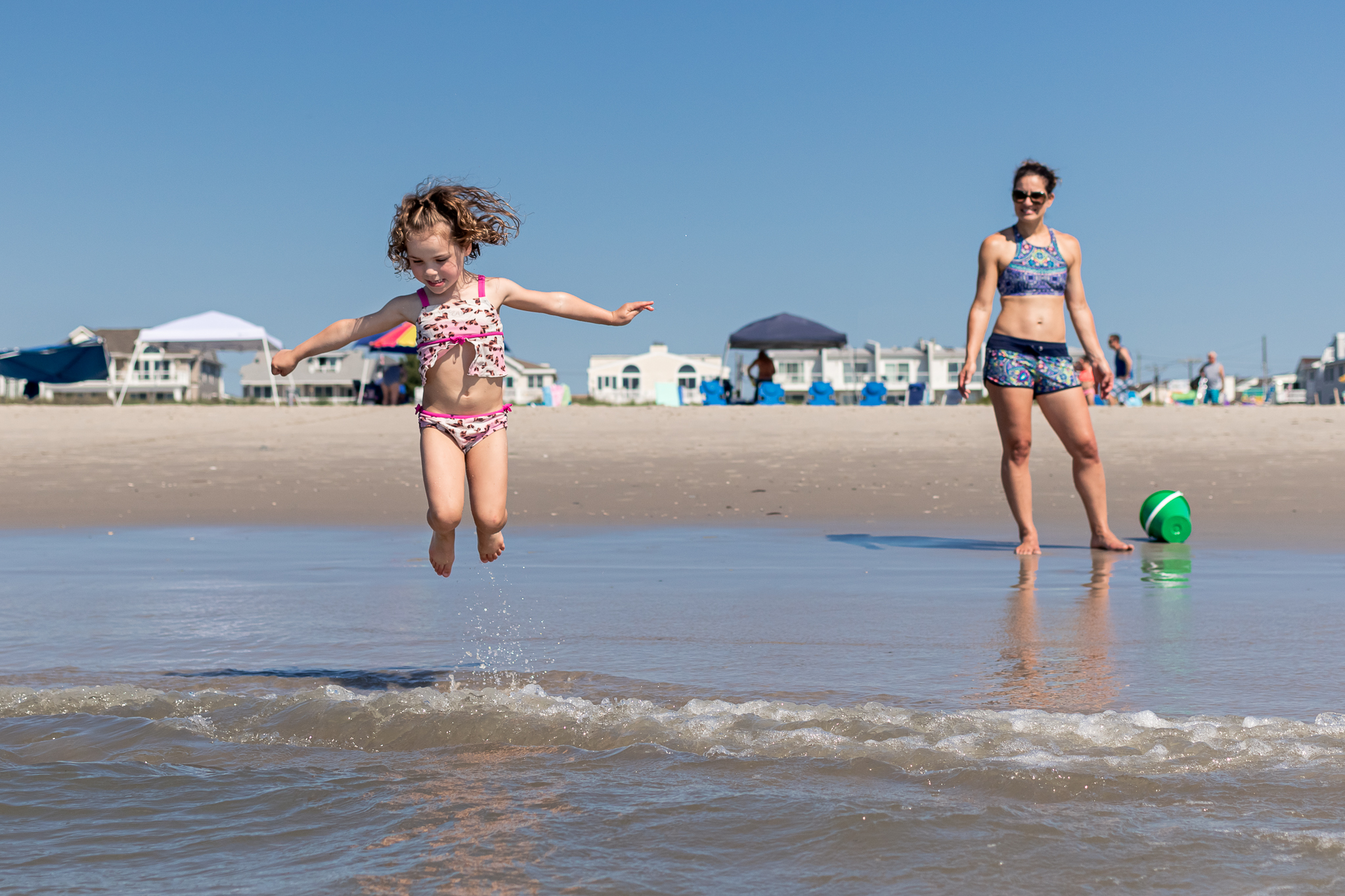 Nancy Elizabeth Photography | Jersey Shore Documentary Beach Photographer | Girl Jumping Waves Mom Watch