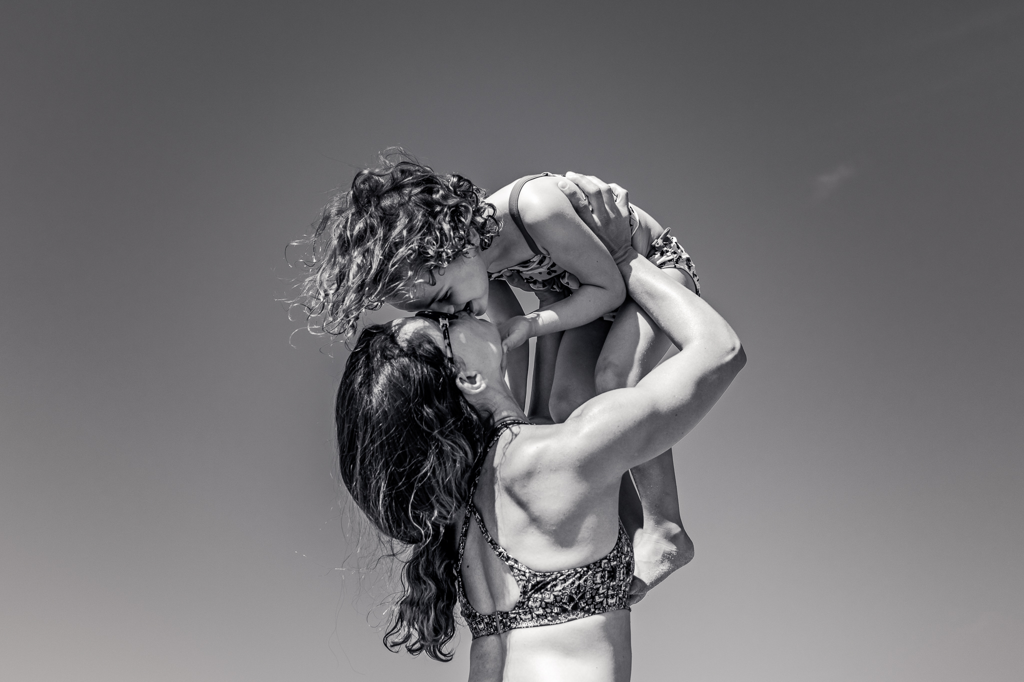Nancy Elizabeth Photography | Jersey Shore Documentary Beach Photographer | Mom Lifting Girl in Air