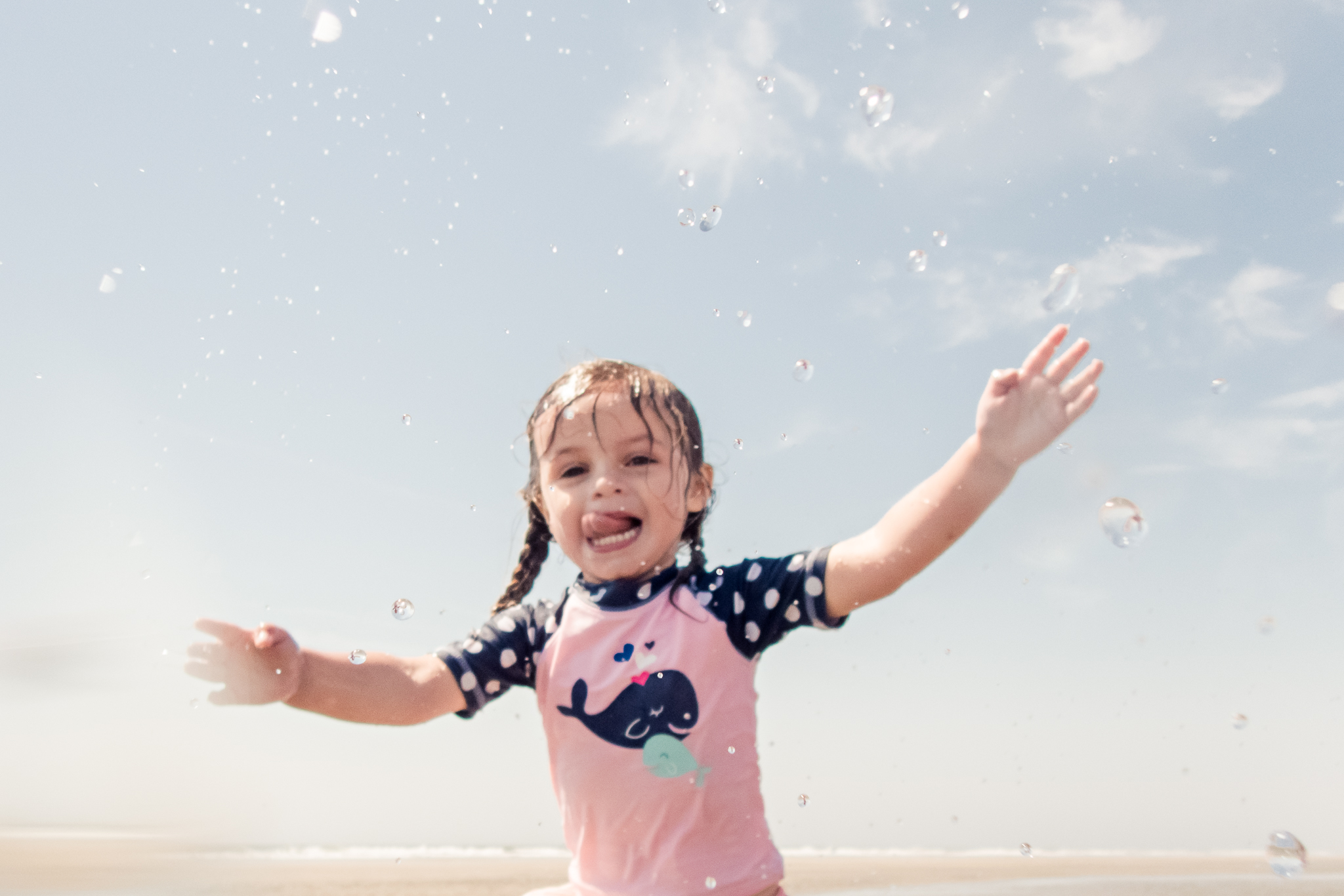 Nancy Elizabeth Photography | Jersey Shore Documentary Beach Photographer | Girl Splashing