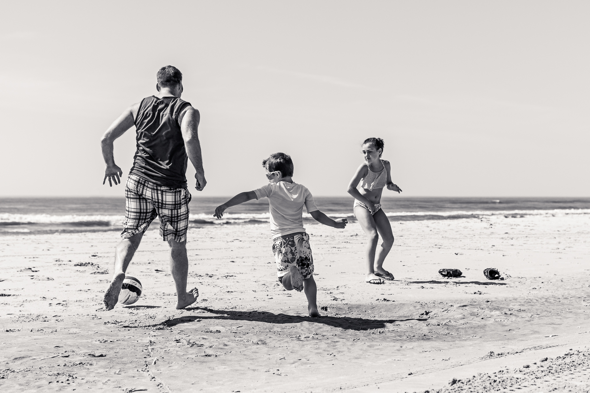 Nancy Elizabeth Photography | Jersey Shore Documentary Beach Photographer | Dad and Kids playing soccer by Ocean