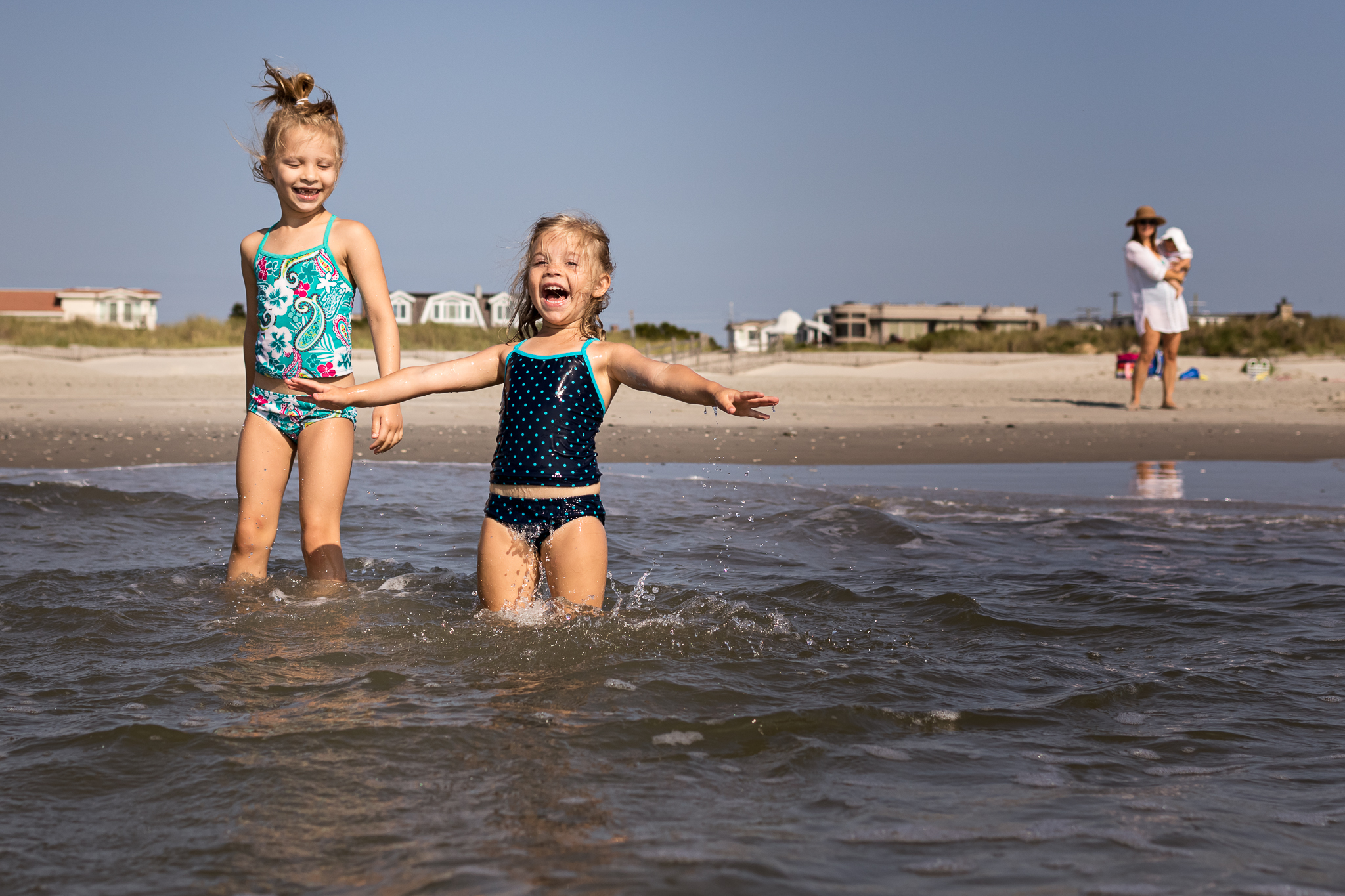 New Jersey Beach Photographer, Sisters Smiling in Ocean