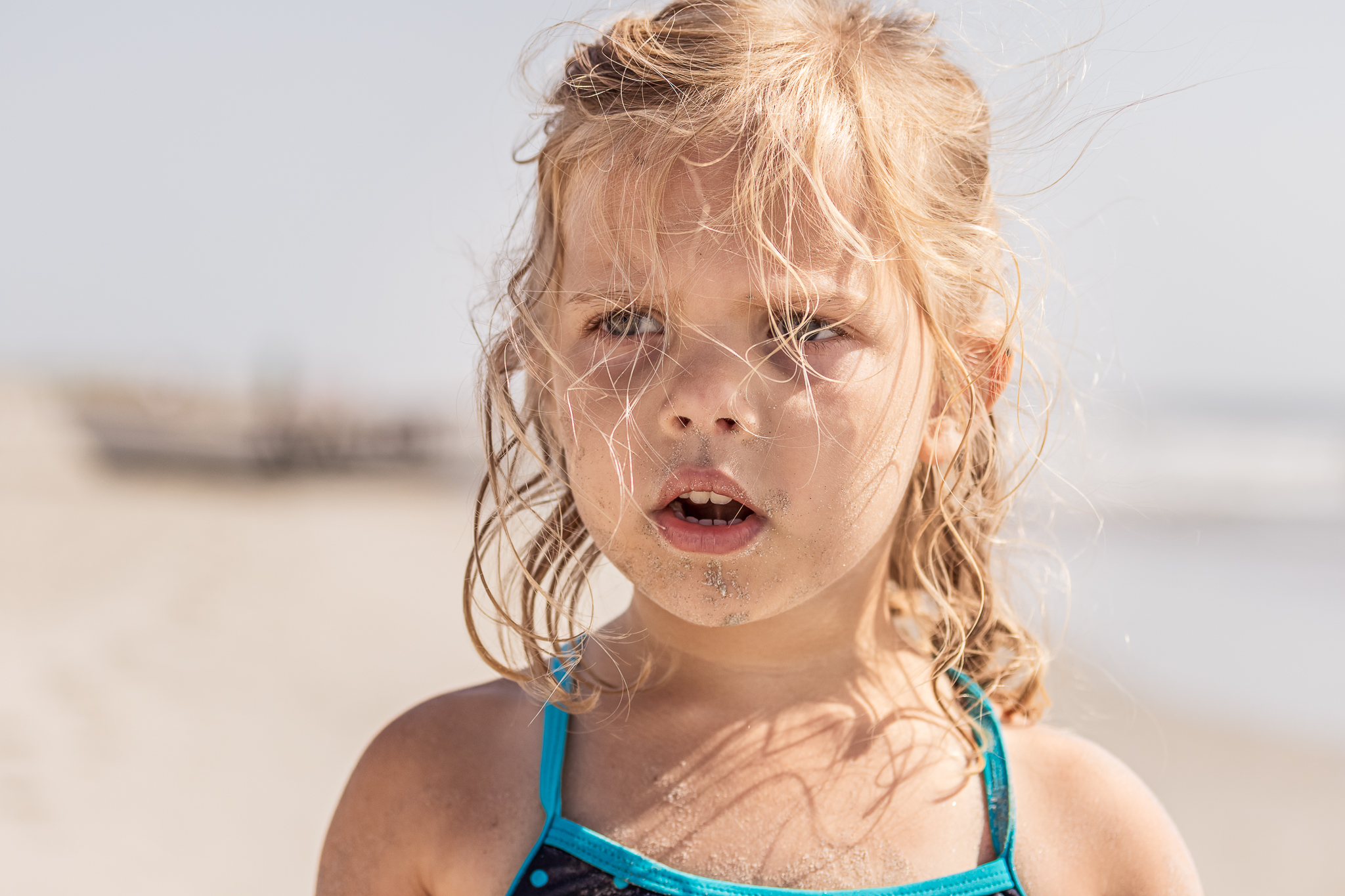 New Jersey Beach Photographer, Sand and Hair in Face of Girl at Beach