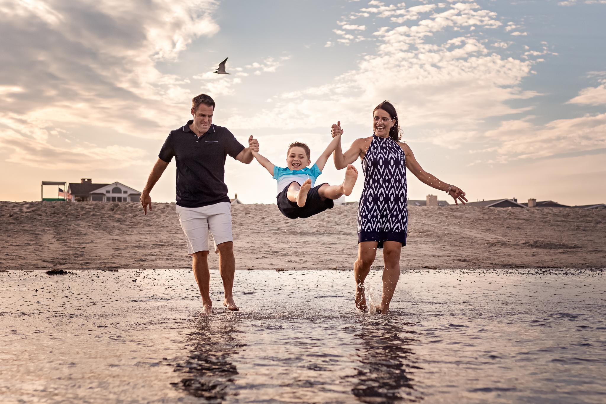 NancyElizabethPhotography, South Jersey Photographer, Swinging son by Ocean
