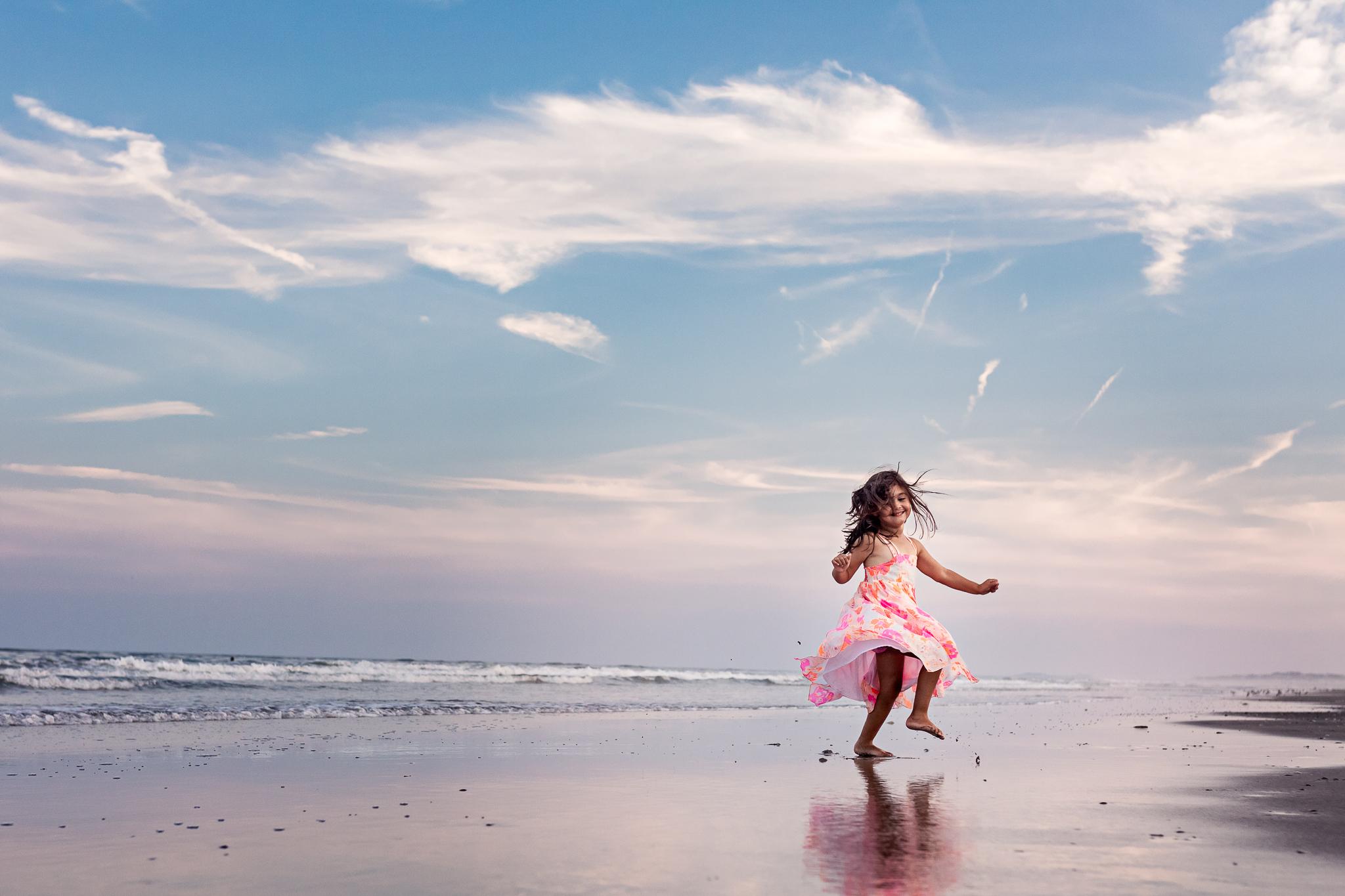NancyElizabethPhotography, South Jersey Photographer, Girl Spinning on New Jersey Beach